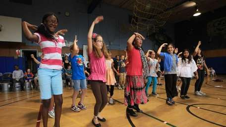 Students at Belmont Elementary School perform a dance