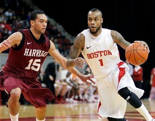 Boston University's Darryl Partin (1) drives past Harvard's