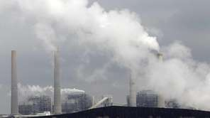 In this file photo, exhaust rises from smokestacks