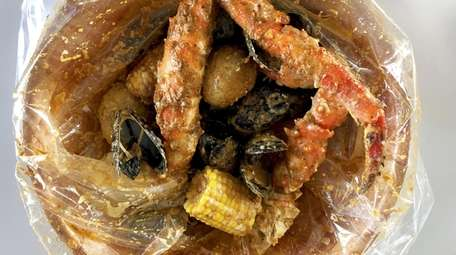 King crab and mussels with Cajun sauce at
