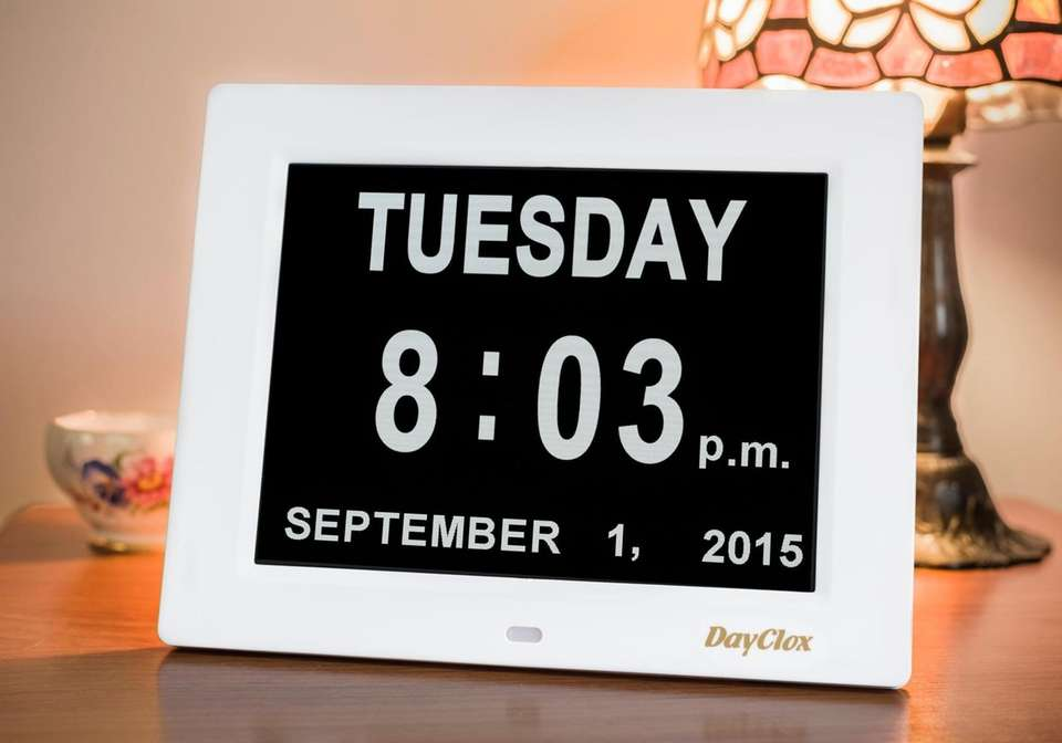 The digital clock features days of the week