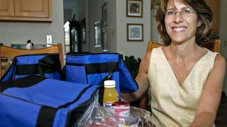 Sherry Claxton, a licensed dietician, oversees her children