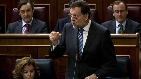 Spanish Prime Minister Mariano Rajoy speaks during a