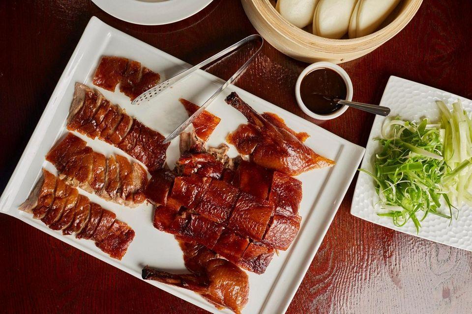 Whole peking duck served with eight bao, scallion,
