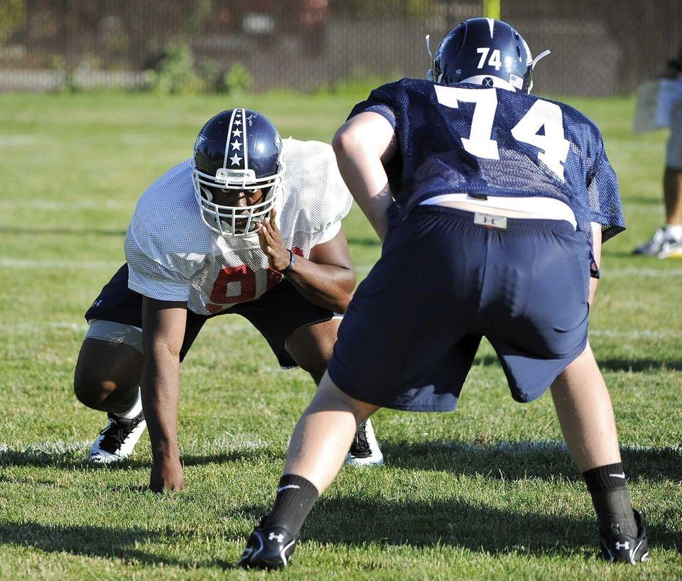 Team Long Island defensive end Aaron Thompson #90