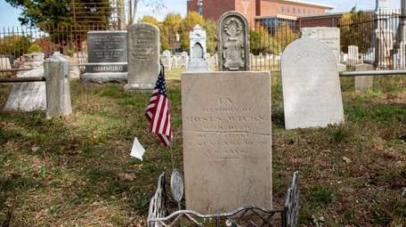 The restored headstone of veteran Moses Wicks, at
