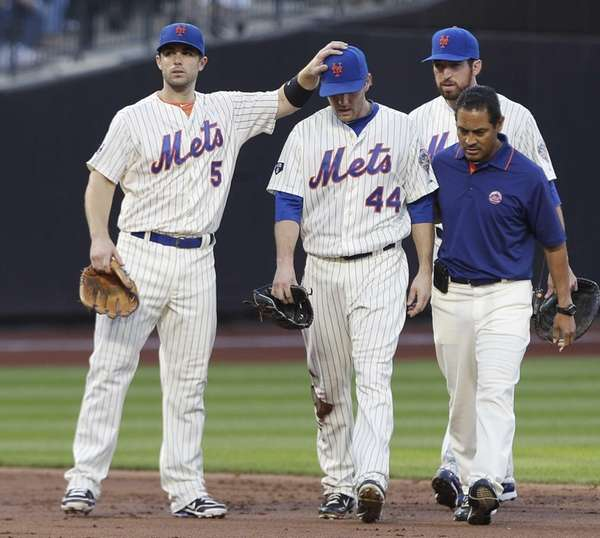 David Wright, left, gives encouragement to teammate Jason