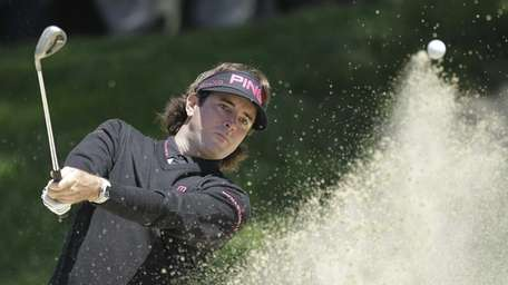 Bubba Watson hits out of a bunker on