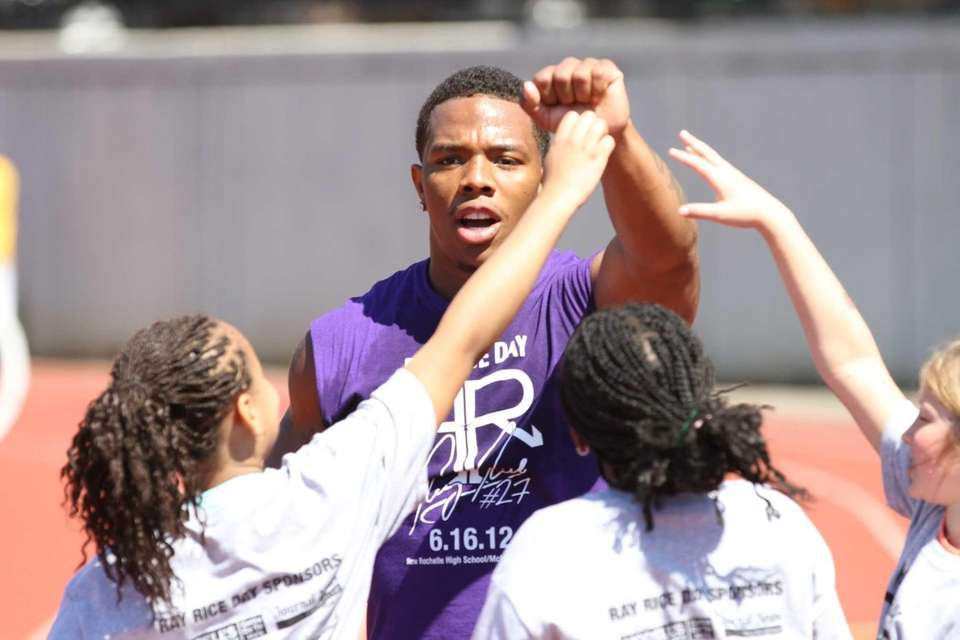Ray Rice celebrates with participants after finishing jumping