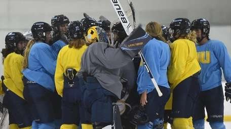 LIU women's ice hockey players gather at the