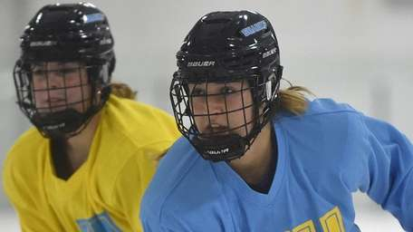 Grace Dima (right), LIU women's ice hockey player