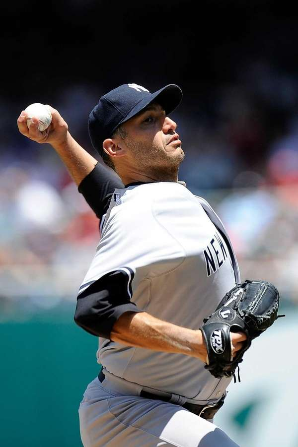 Andy Pettitte throws a pitch against the Washington