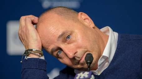 Yankees GM Brian Cashman speaks to reporters at