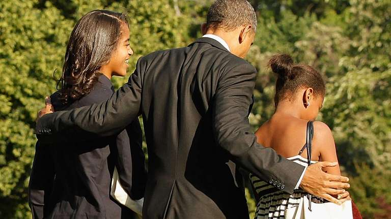 President Barack Obama and his daughters Malia and