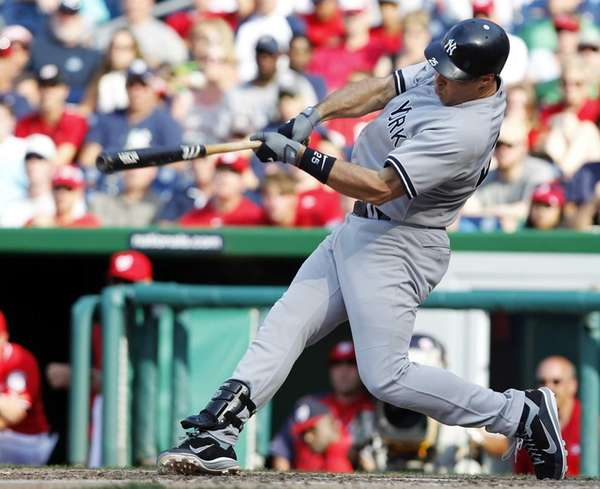 Mark Teixeira connects for a two-run double during