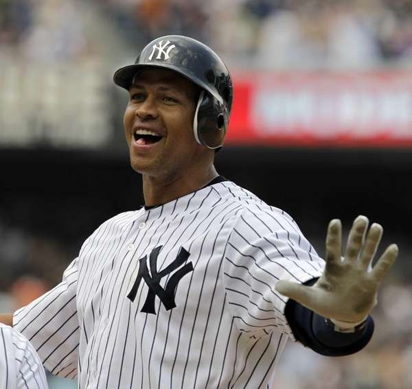 Alex Rodriguez reacts at first base after hitting