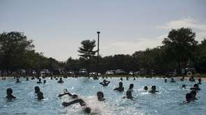 Swimmers splash and play on a beautiful summer