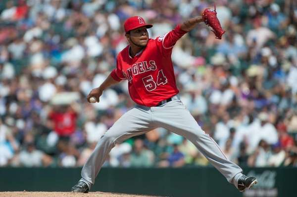 Ervin Santana delivers a pitch during a game