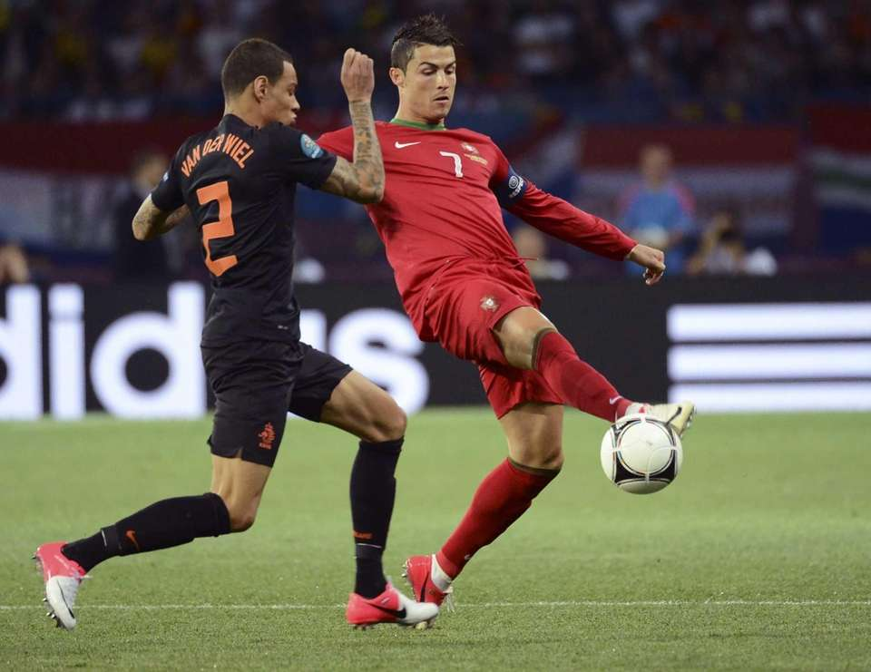 Gregory van der Wiel, left, from the Netherlands