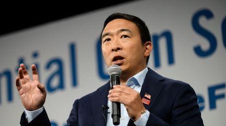 Andrew Yang speaks during a forum on gun