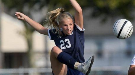 Julie Strianese of Oceanside knocks the ball down