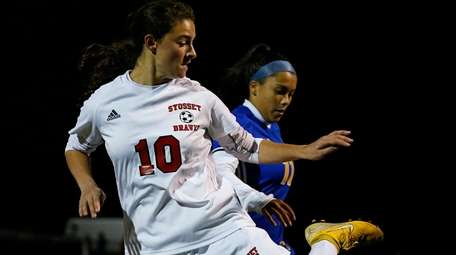 Isabella Romano of Syosset battles for the ball