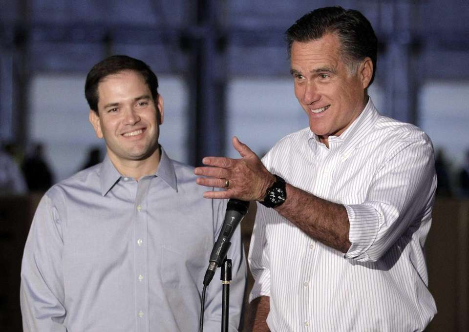 Mitt Romney and Sen. Marco Rubio talk to