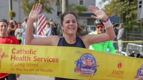 Maggie Tursi crosses the finish line as the