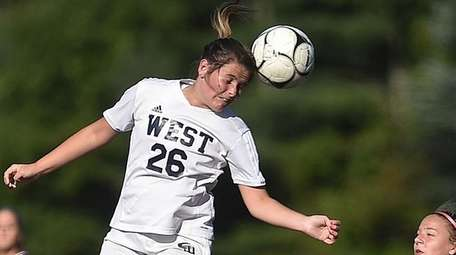 Jillian Meaney of Smithtown West makes a header