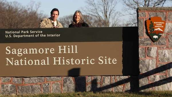 left and volunteer margrethe randall pose for a portrait by the entrance sign to the sagamore hill national historic site in oyster bay jan