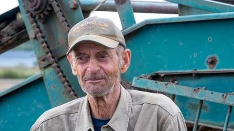 John Nierodzik, a retired farmer from Southold lends
