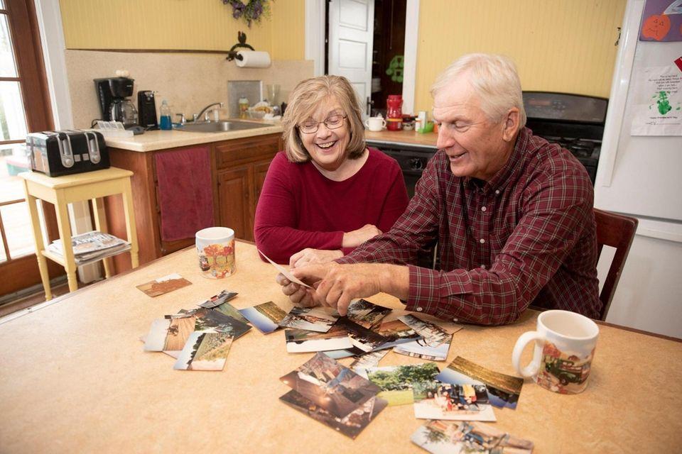 Carol and Martin Sidor look at family photographs
