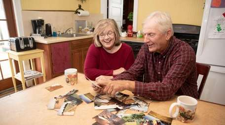 Carol and Martin Sidor look at family photographs