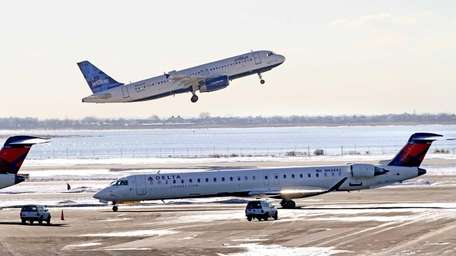 A Delta Connection CRJ-900 regional jet taxis near
