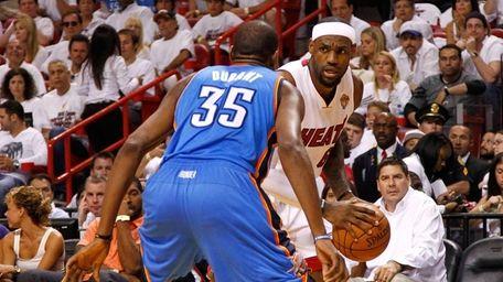 LeBron James #6 of the Miami Heat looks