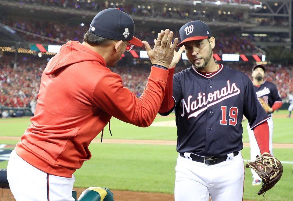 Gerardo Parra embraces Victor Robles of the Washington