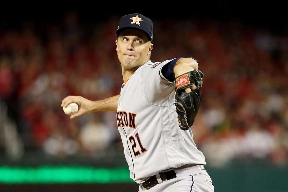 Zack Greinke of the Houston Astros delivers the