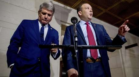 Zeldin, right, accompanied by Rep. Mike McCaul (R-Texas),