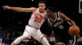 Caris LeVert of the Nets drives to the