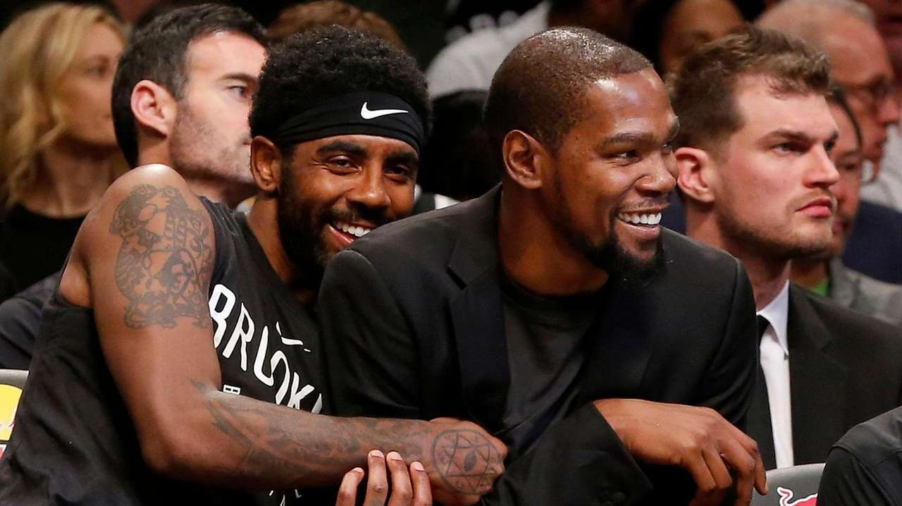 Kyrie Irving #11 and Kevin Durant #7 of