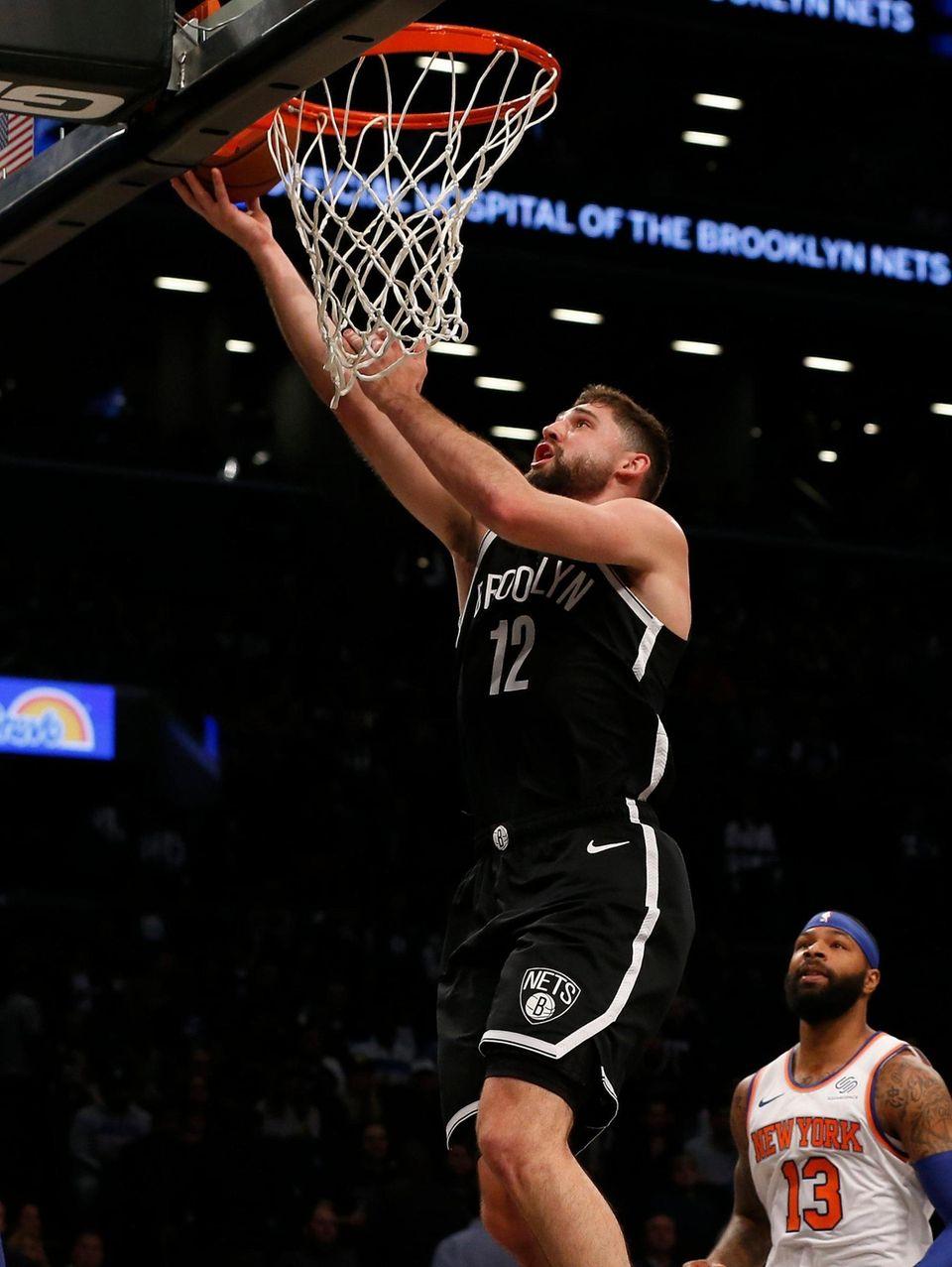 Joe Harris #12 of the Brooklyn Nets goes