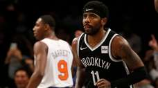 Kyrie Irving #11 of the Nets reacts after