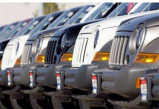 A line of Jeep Liberties sit on