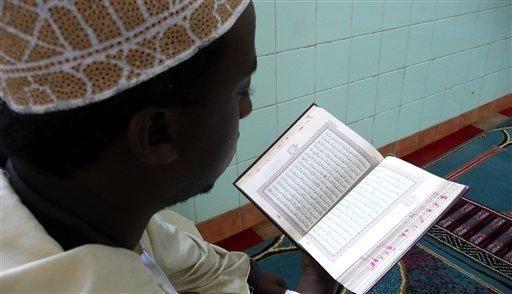A Kenyan Muslim recite the Holy Quran, before