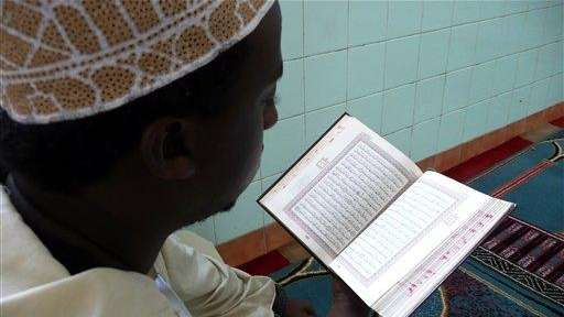 A Kenyan Muslim recite the Holy Quran, before