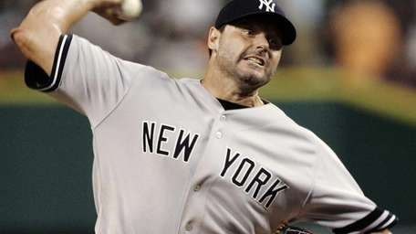New York Yankees pitcher Roger Clemens throws against