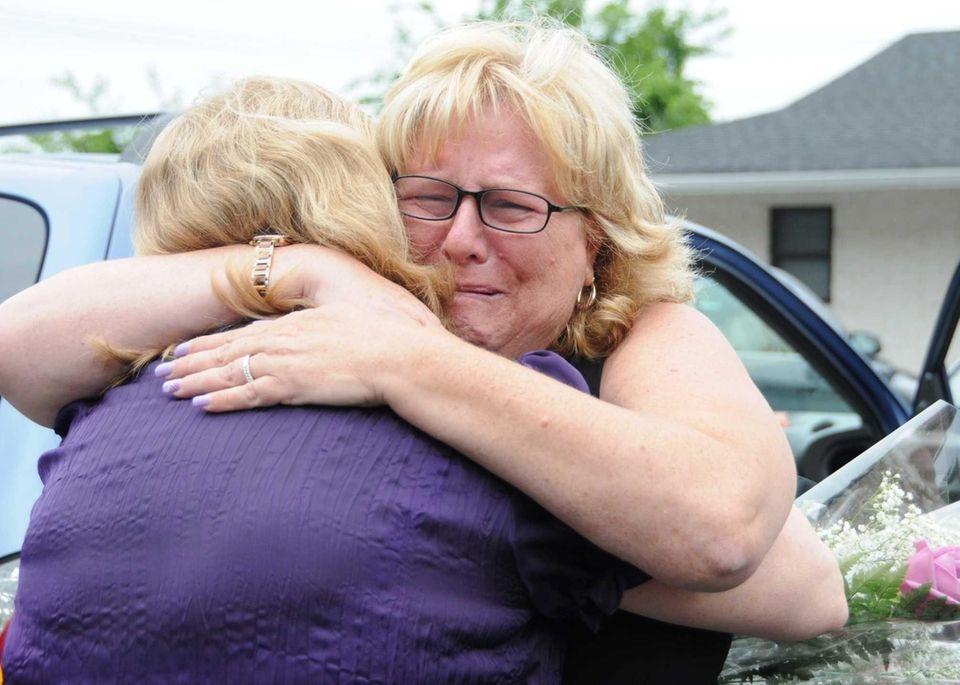 Pat Taccetta, facing camera, mother of pharmacy shooting