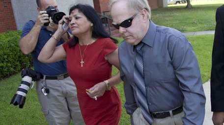 Harvey Updyke arrives with his wife Elva at