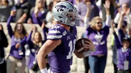 Kansas State quarterback Skylar Thompson runs into the