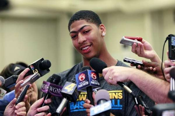 Anthony Davis talks to reporters while visiting the